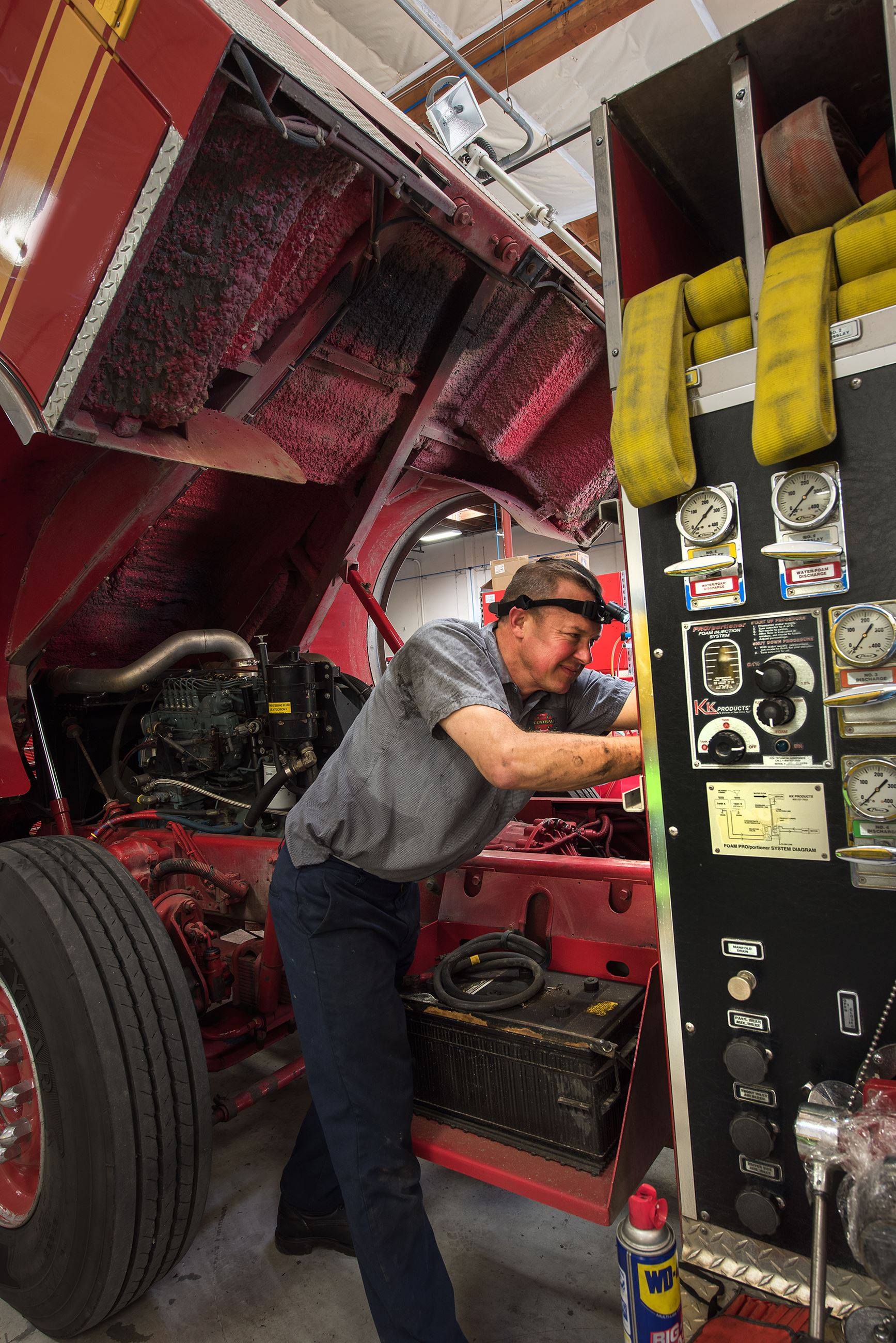 Fire Apparatus Technician working on fire engine.